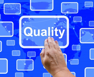 Hand pressing a quality button - yu MUST have quality in your marketing