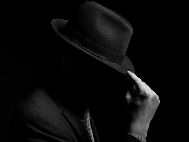 Hacker, tilting his hat